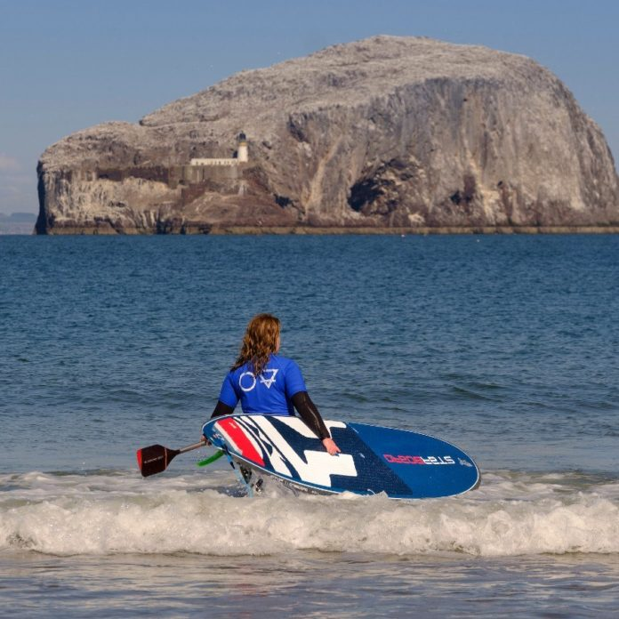 SUP paddle boarding with Starboard on Seacliff Beach in East Lothian with the Bass Rock in the background
