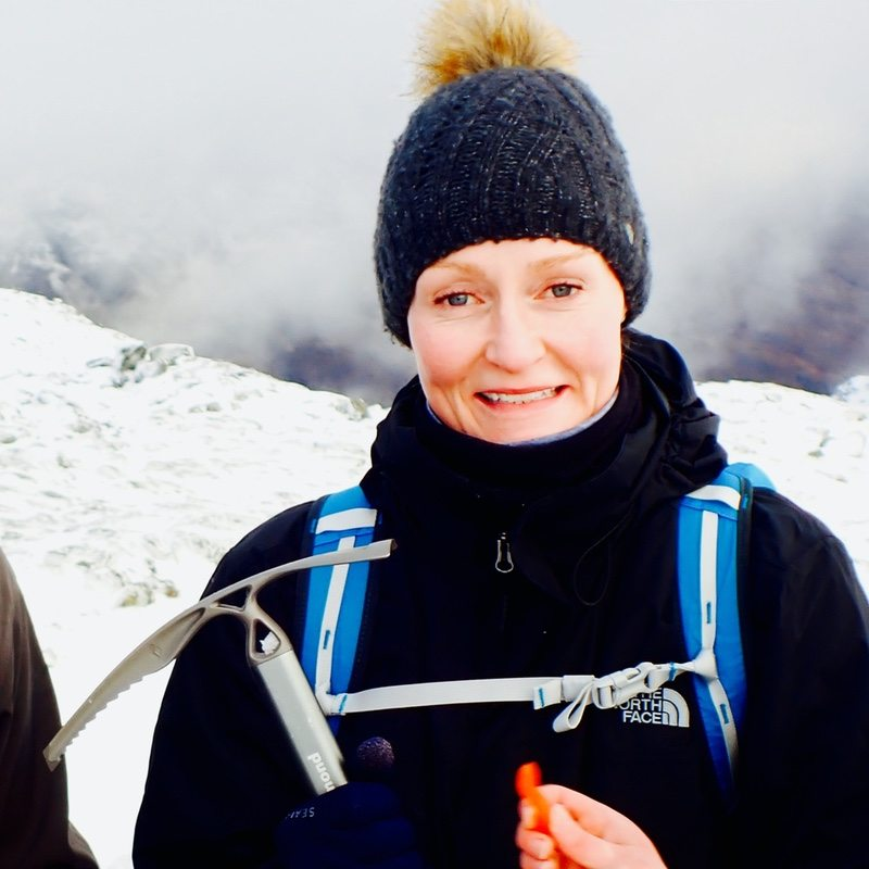 winter mountaineering with ice axe Glen Coe Scotland