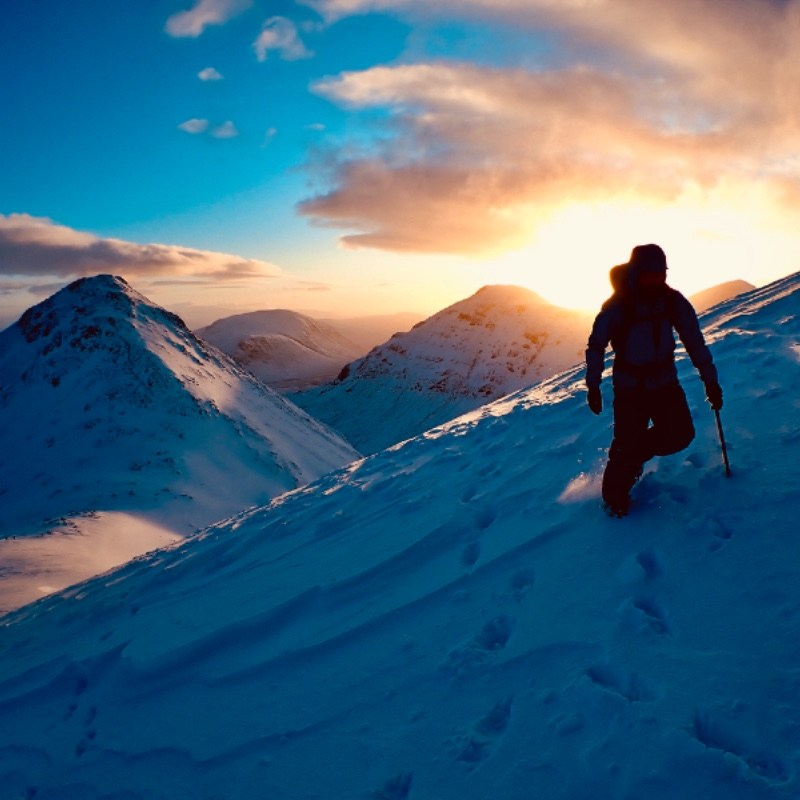 Winter mountaineering at sunrise in Glen Coe looking towards Buachaille Etive Mor from Buachaille Etive Beag
