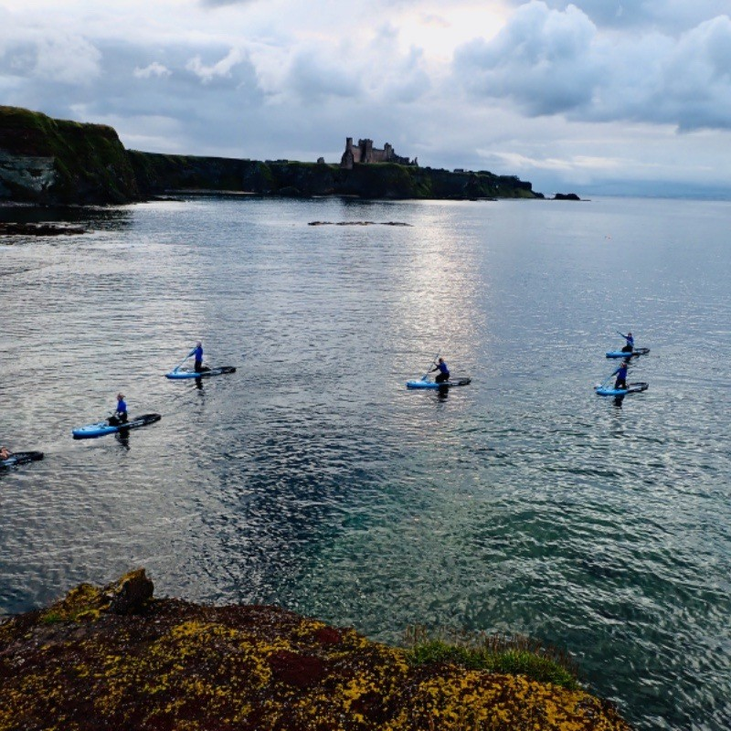 paddle boarding SUP by Tantallon Castle East Lothian Scotland