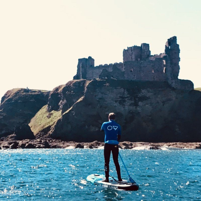 paddle boarding SUP by Tantallon Castle North Berwick and Dunbar East Lothian