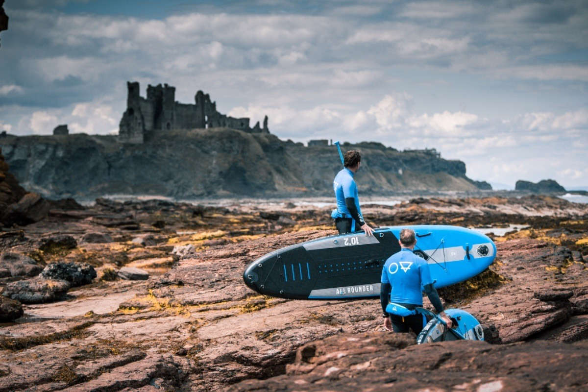 paddle boarding adventure by Tantallon Castle on Seacliff Beach in East Lothian Scotland