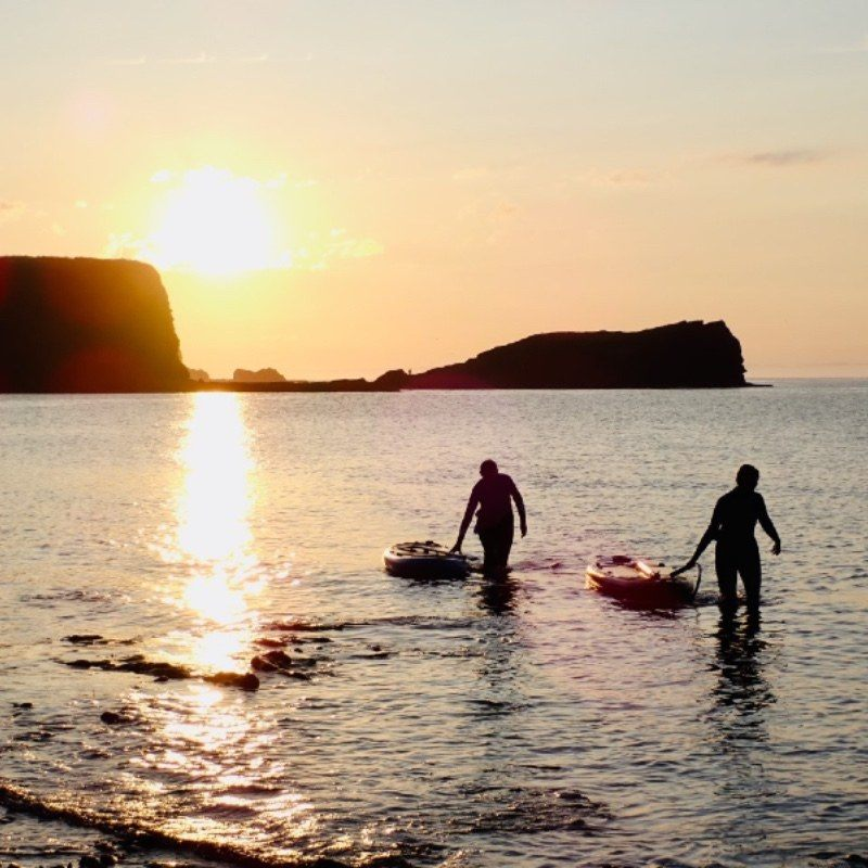 sunset paddle boarding SUP in East Lothian at Seacliff Beach by Dunbar and North Berwick