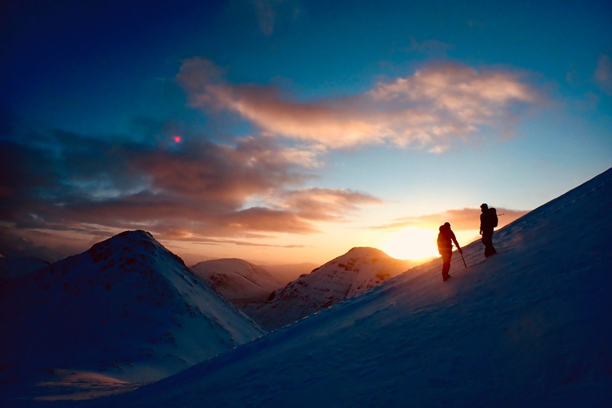 winter mountaineering and sunrise over glen coe scotland 2