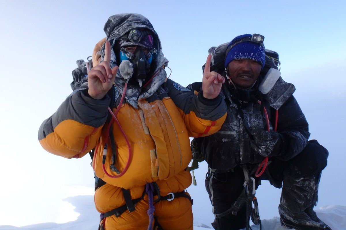 Mollie Hughes and Lhakpa Wongchu Sherpa on the summit of Mount Everest 2017
