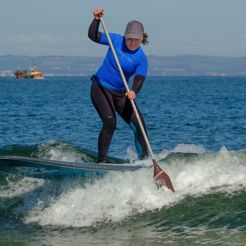 Mollie Hughes is SUP surfing at Seacliff Beach in East Lothian with Ocean vertical