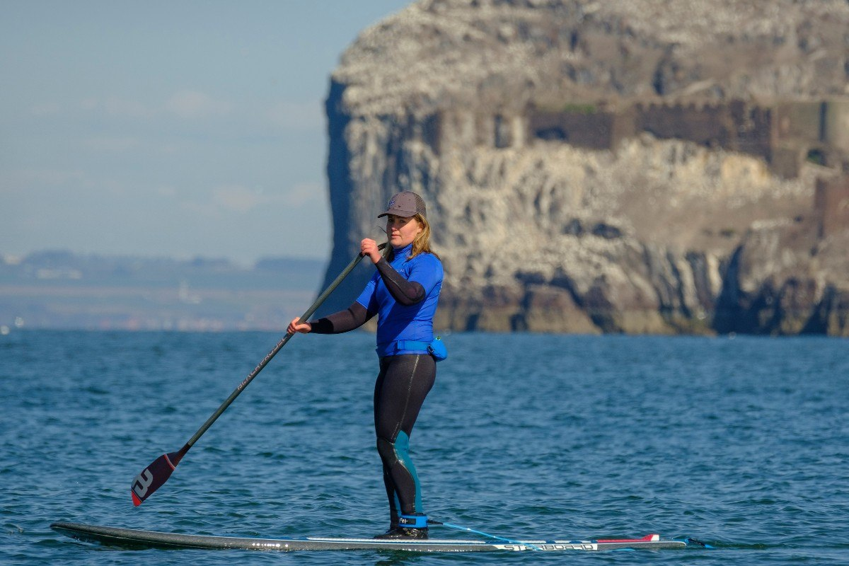 SUP paddle boarding at seacliff beach in east lothian with ocean vertical 1