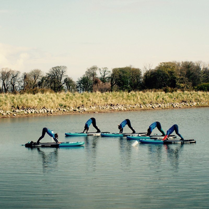 10 sup yoga downward dog position east lothian by the coast and seacliff beach for a new perspective and fun experience