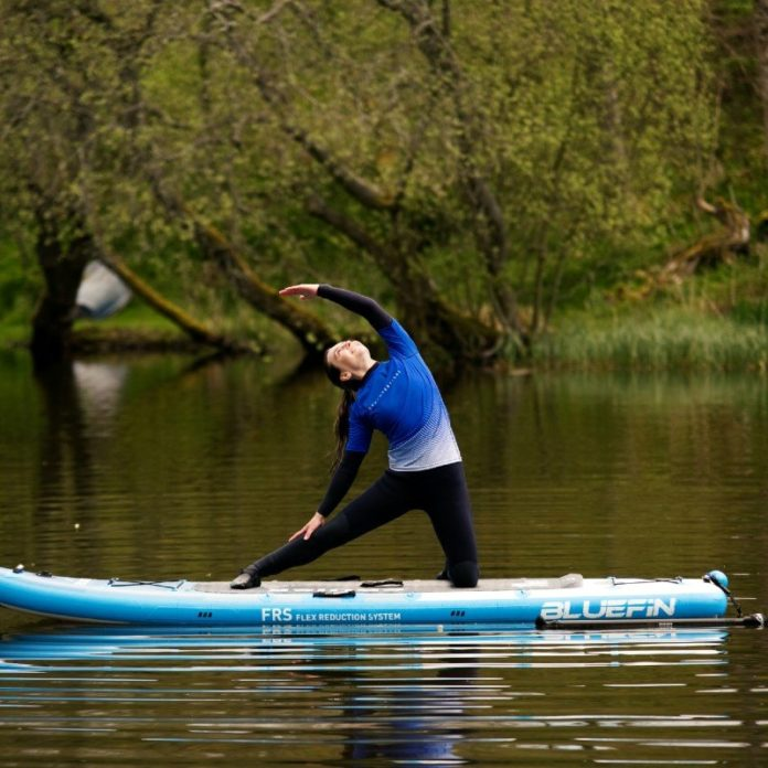 8 beautiful loch near edinburgh scotland quiet and sheltered by nature and bird song gate pose stretch sup yoga