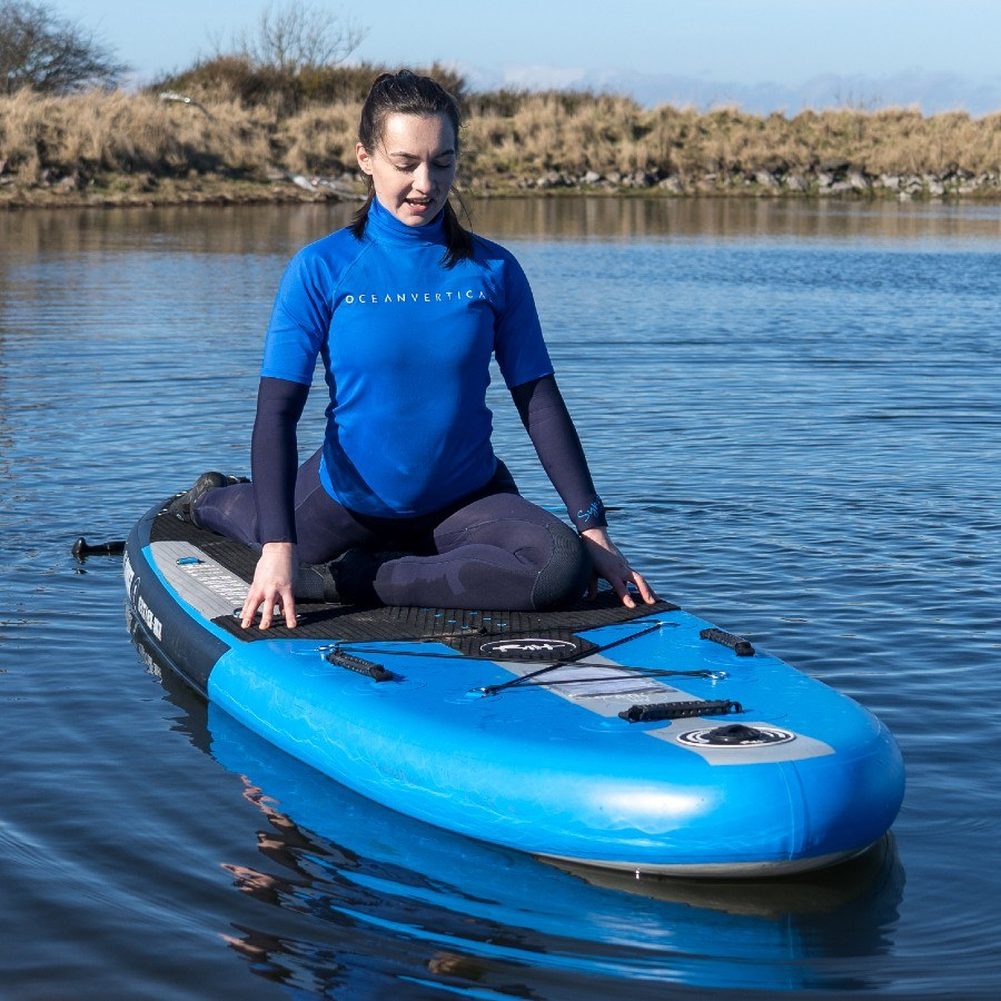 SUP yoga instructor on paddle board by north berwick and dunbar east lothian
