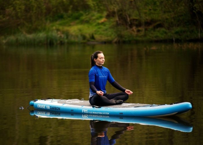 sup paddle board yoga with ocean vertical on a peaceful scottish loch meditation and mindfulness surrounded by nature